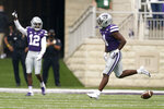 Kansas State defensive back Wayne Jones (4) celebrates after recovering an Arkansas State fumble during the first half of an NCAA college football game Saturday, Sept. 12, 2020, in Manhattan, Kan. (AP Photo/Charlie Riedel)