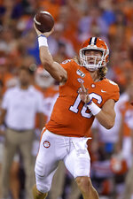 Clemson quarterback Trevor Lawrence throws a pass during the first half of the team's NCAA college football game against Charlotte on Saturday, Sept. 21, 2019, in Clemson, S.C. (AP Photo/Richard Shiro)