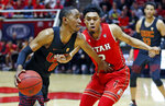 Southern California guard Shaqquan Aaron (0) drives as Utah guard Sedrick Barefield, right, defends in the first half during an NCAA college basketball game Thursday, March 7, 2019, in Salt Lake City. (AP Photo/Rick Bowmer)