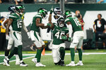 New York Jets' Kenny Yeboah (48) celebrates after making a catch for a touchdown during the second half of an NFL preseason football game Friday, Aug. 27, 2021, in East Rutherford, N.J. The game ended in a 31-31 tie. (AP Photo/John Minchillo)