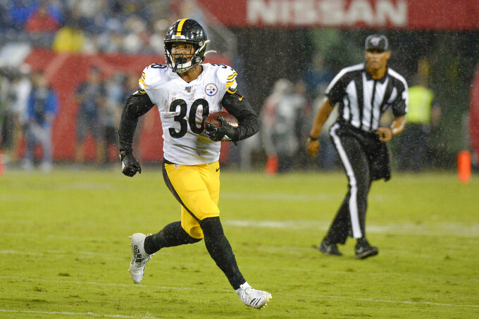 Pittsburgh Steelers running back James Conner runs the ball against the Tennessee Titans in the first half of a preseason NFL football game Sunday, Aug. 25, 2019, in Nashville, Tenn. (AP Photo/Mark Zaleski)