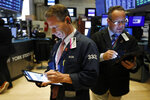 Trader Robert Charmak, left, works on the floor of the New York Stock Exchange, Monday, Oct. 7, 2019. Stocks are opening broadly lower on Wall Street, extending the market's losing streak into a fourth week. (AP Photo/Richard Drew)