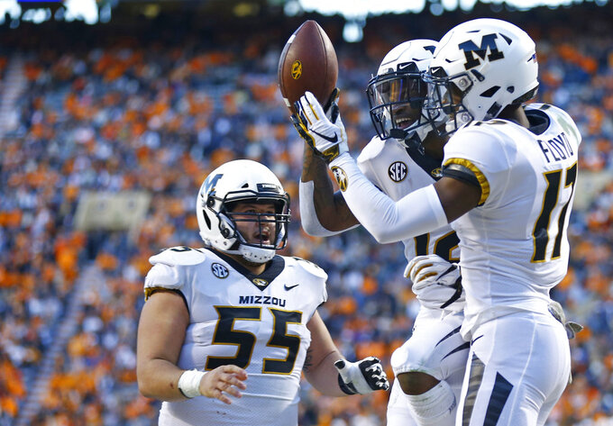 Missouri wide receiver Johnathon Johnson (12) celebrates scoring a touchdown with Richaud Floyd (17) and Trystan Colon-Castillo (55) in the first half of an NCAA college football game against Tennessee Saturday, Nov. 17, 2018, in Knoxville, Tenn. (AP Photo/Wade Payne)
