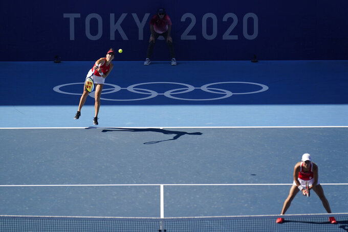 Belinda Bencic, of Switzerland, servers during the women's doubles gold medal match of the tennis competition against the Czech Republic at the 2020 Summer Olympics, Sunday, Aug. 1, 2021, in Tokyo, Japan. (AP Photo/Seth Wenig)