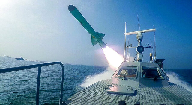 In this photo released Tuesday, July 28, 2020, by Sepahnews, a Revolutionary Guard's speed boat fires a missile during a military exercise. Iranian commandos also fast-roped down from a helicopter onto a replica of an aircraft carrier in the exercise called