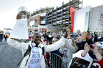 New England Patriots cornerback Jason McCourty, left, holds the Super Bowl trophy as he greets fans following the football team's arrival at Gillette Stadium, Monday, Feb. 4, 2019, in Foxborough, Mass, after defeating the Los Angeles Rams Sunday in NFL Super Bowl 53, in Atlanta, Ga. (AP Photo/Steven Senne)
