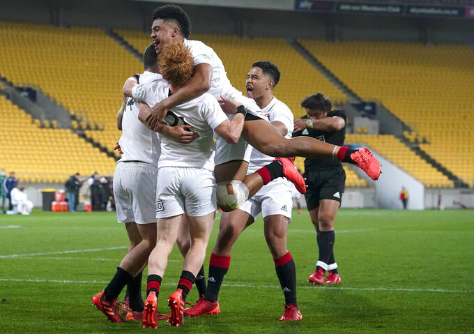 South's players celebrate after defeating North in their rugby game in Wellington, New Zealand, Saturday, Sept. 5, 2020. The All Blacks which will be named Sunday, Sept 6. (John Cowpland/Photosport via AP)