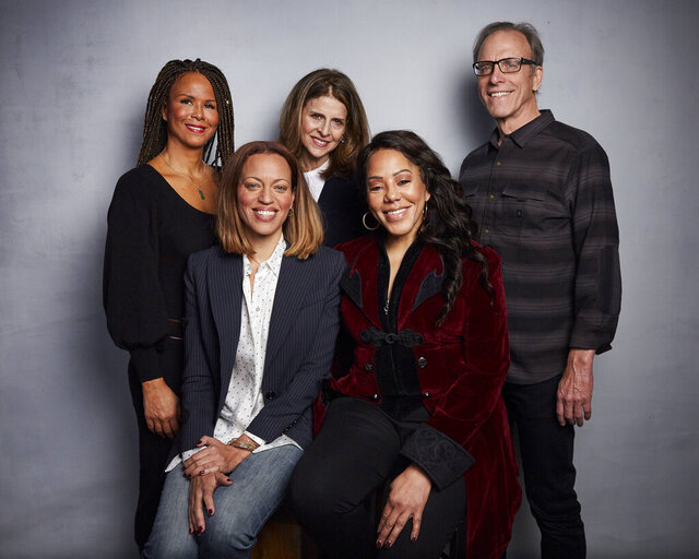 FILE - In this Jan. 26, 2020 file photo, Sil Lai Abrams, back row from left, director Amy Ziering, director Kirby Dick, Drew Dixon, seated left, and Sheri Hines pose for a portrait to promote the film