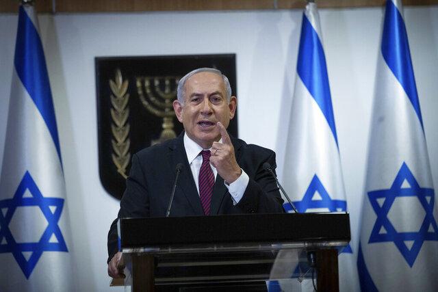Israeli Prime Minister Benjamin Netanyahu delivers a statement at the Israeli Knesset, or Parliament, in Jerusalem, Tuesday, Dec. 22, 2020. Netanyahu said,