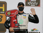 Austin Cindric holds his trophy in Victory Lane after winning the NASCAR Xfinity Series auto race at Daytona International Speedway, Saturday, Aug. 15, 2020, in Daytona Beach, Fla. (AP Photo/Terry Renna)