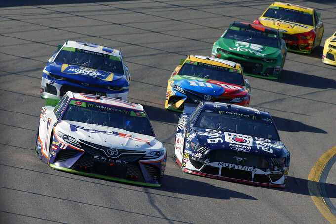 Denny Hamlin (11) drives out of Turn 4 ahead of Brad Keselowski (2), Chase Elliott (9) and Kyle Busch (18) during a NASCAR Cup Series auto race at ISM Raceway, Sunday, Nov. 10, 2019, in Avondale, Ariz. (AP Photo/Ralph Freso)