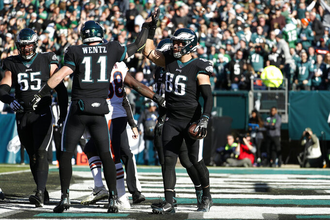 Philadelphia Eagles' Zach Ertz (86) and Carson Wentz (11) celebrate after Ertz's touchdown during the first half of an NFL football game against the Chicago Bears, Sunday, Nov. 3, 2019, in Philadelphia. (AP Photo/Chris Szagola)