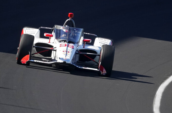 Marco Andretti drives into turn one during a practice session for the Indianapolis 500 auto race at Indianapolis Motor Speedway, Sunday, Aug. 16, 2020, in Indianapolis. (AP Photo/Darron Cummings)