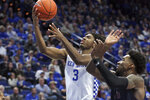 Kentucky's Tyrese Maxey (3) shoots while defended by Fairleigh Dickinson's Kaleb Bishop (12) during the second half of an NCAA college basketball game in Lexington, Ky., Saturday, Dec. 7, 2019. (AP Photo/James Crisp)