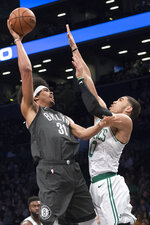 Brooklyn Nets center Jarrett Allen (31) goes to the basket against Boston Celtics forward Jayson Tatum (0) during the first half of an NBA basketball game, Saturday, March 30, 2019, in New York. (AP Photo/Mary Altaffer)