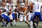 Texas quarterback Sam Ehlinger (11) scrambles for yards against Louisiana Tech during the first half of an NCAA college football game, Saturday, Aug. 31, 2019, in Austin, Texas. (AP Photo/Eric Gay)