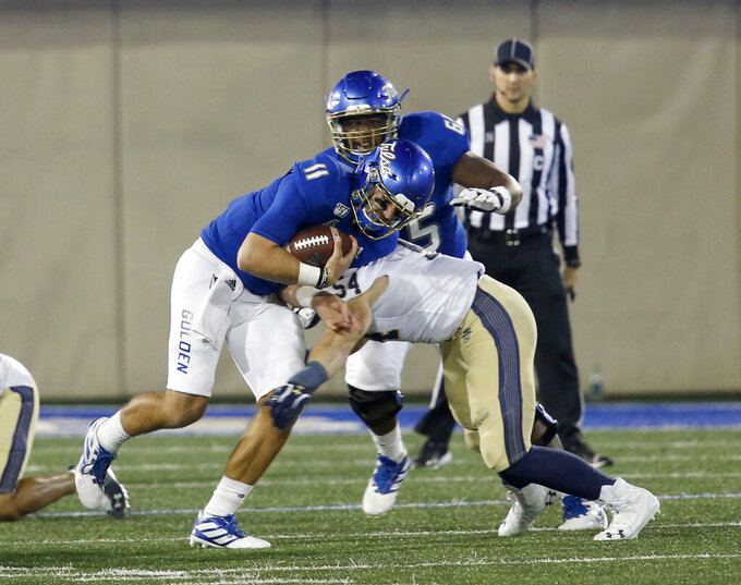 Tulsa quarterback Zack Smith (11) is taken down by Navy's Diego Fagot (54) during an NCAA college football game, Saturday, Oct. 12, 2019, in Tulsa, Okla. (Stephen Pingry/Tulsa World via AP)