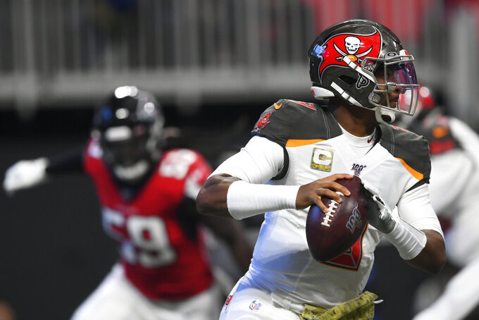 Tampa Bay Buccaneers quarterback Jameis Winston (3) runs out of the pocket against the Atlanta Falcons during the first half of an NFL football game, Sunday, Nov. 24, 2019, in Atlanta. (AP Photo/John Amis)