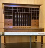 A merchant's desk, built about 1855, is shown in the atrium of the Abraham Lincoln Presidential Library on Thursday, Sept. 16, 2021 in Springfield, Ill.. The desk that Abraham Lincoln used to draft the presidential inaugural address he delivered on March 4, 1861, on the eve of the Civil War, is on display free to the public. Lincoln needed a quiet place away from well-wishers to write the speech, and his brother-in-law, Clark Moulton Smith, offered him a third-floor storage room in the store he owned on the state Capitol square in downtown Springfield. The state purchased the desk from the Smith family in 1953 and this summer spent $6,300 to have it historically restored and repaired. (AP Photo/John O'Connor)