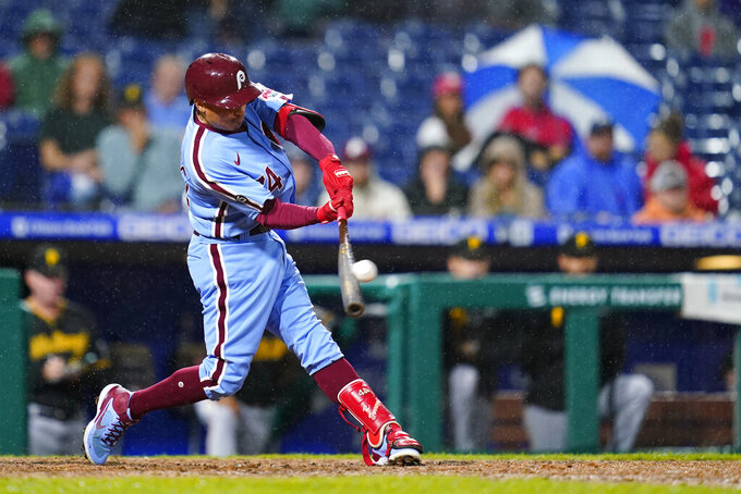Philadelphia Phillies' Ronald Torreyes hits a three-run home run against Pittsburgh Pirates pitcher Anthony Banda during the sixth inning of a baseball game, Thursday, Sept. 23, 2021, in Philadelphia. (AP Photo/Matt Slocum)