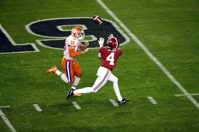 Alabama's Jerry Jeudy catches a touchdown pass in front of Clemson's Tanner Muse during the first half the NCAA college football playoff championship game, Monday, Jan. 7, 2019, in Santa Clara, Calif. (AP Photo/Jeff Chiu)