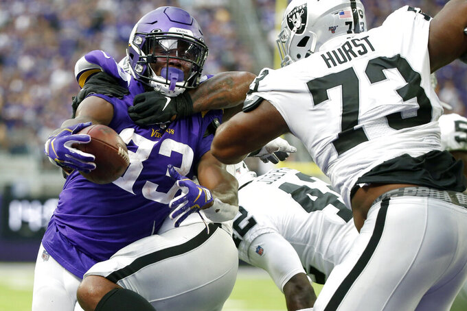 Raiders start long road stretch with 34-14 loss to Vikings