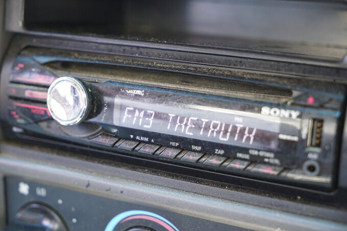 """The radio in Alton Lucas' pickup is set to his favorite religious station as he does errands around Raleigh, N.C., on Friday, June 18, 2021. Lucas said he still wonders what would happen for him and his family if he no longer carried the weight of a drug-related conviction on his record. """"So occasionally, I would go apply for a job just to make them do the background check. I'm making them come back and tell me what they found. And I want to see how they are going to respond to me. ... It's almost like a life sentence."""" (AP Photo/Allen G. Breed)"""