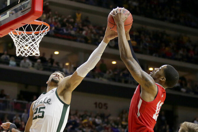 Bradley's Elijah Childs (10) and Michigan State's Kenny Goins (25) compete for a rebound during the first half of a first round men's college basketball game in the NCAA Tournament in Des Moines, Iowa, Thursday, March 21, 2019. (AP Photo/Nati Harnik)