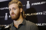 Carolina Hurricanes' Dougie Hamilton faces reporters during a media availability Wednesday, May 8, 2019, in Boston, in advance of Thursday's Game 1 of the NHL hockeyStanley Cup Eastern Conference finals against the Boston Bruins. (AP Photo/Steven Senne)