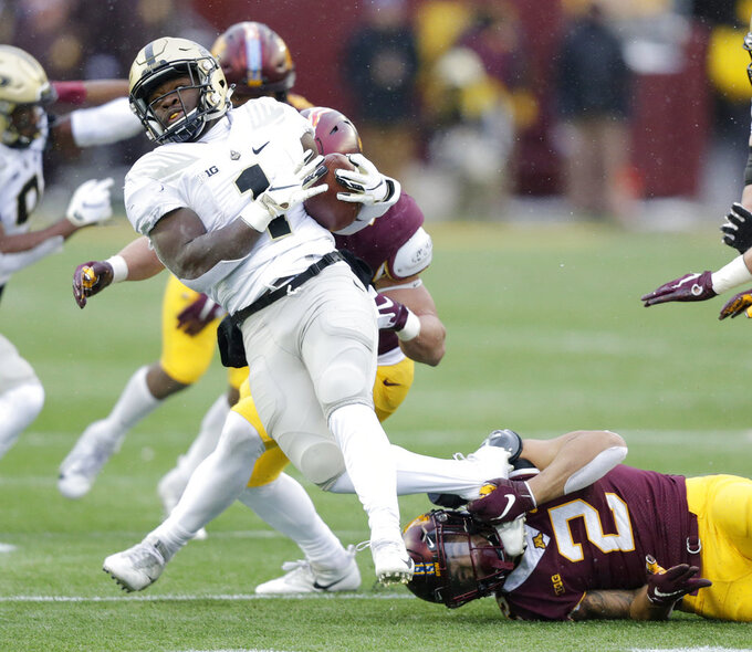 Purdue running back D.J. Knox (1) is tackled by Minnesota defensive back Jacob Huff (2) in the first quarter against Minnesota in a NCAA college football game Saturday, Nov. 10, 2018, in Minneapolis. (AP Photo/Andy Clayton-King)