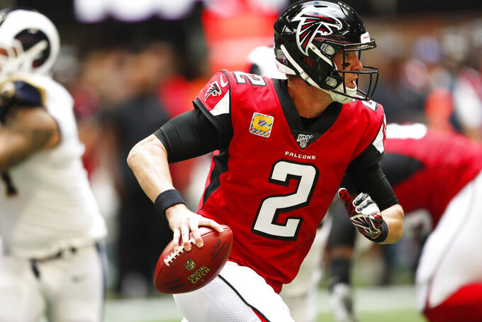 Atlanta Falcons quarterback Matt Ryan (2) runs out of the pocket against the Los Angeles Rams during the first half of an NFL football game, Sunday, Oct. 20, 2019, in Atlanta. (AP Photo/John Bazemore)