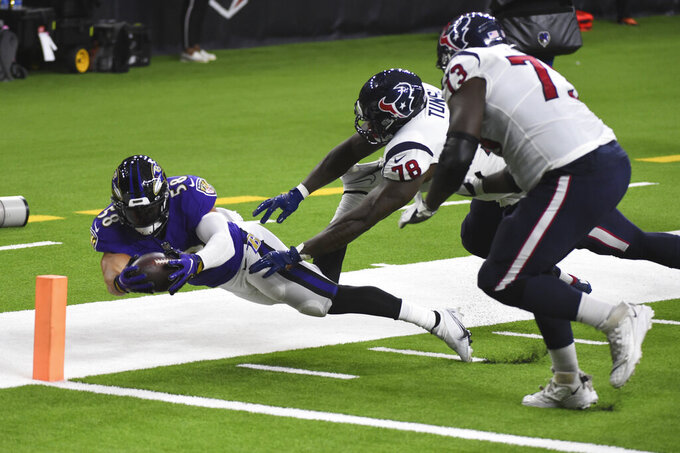 Baltimore Ravens linebacker L.J. Fort (58) scores a touchdown on a fumble recovery past Houston Texans offensive tackle Laremy Tunsil (78) and offensive guard Zach Fulton (73) during the first half of an NFL football game Sunday, Sept. 20, 2020, in Houston. (AP Photo/Eric Christian Smith)