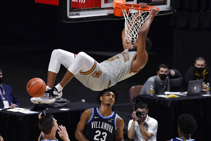 Boston College's Frederick Scott dunks over Villanova's Jermaine Samuels (23) during the first half of an NCAA college basketball game Wednesday, Nov. 25, 2020, in Uncasville, Conn. (AP Photo/Jessica Hill)