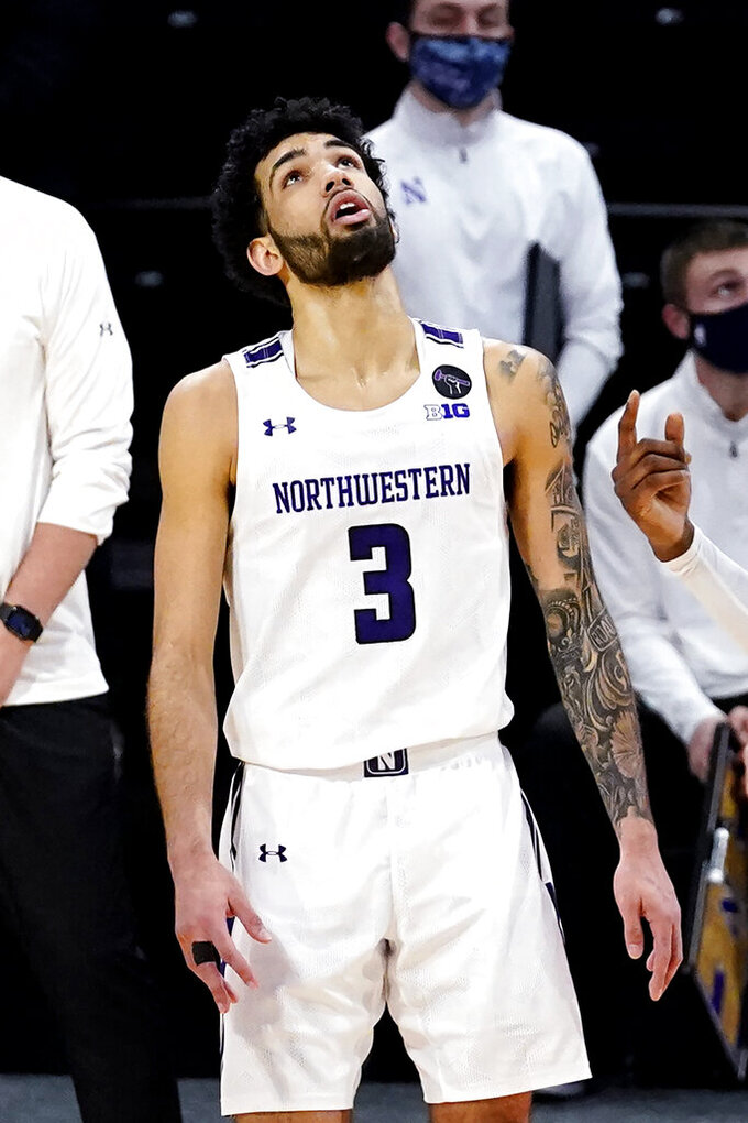 Northwestern guard Boo Buie reacts as he looks up the score board during double overtime of an NCAA college basketball game against Indiana in Evanston, Ill., Wednesday, Feb. 10, 2021. Indiana won 79-76 in double- overtime. (AP Photo/Nam Y. Huh)