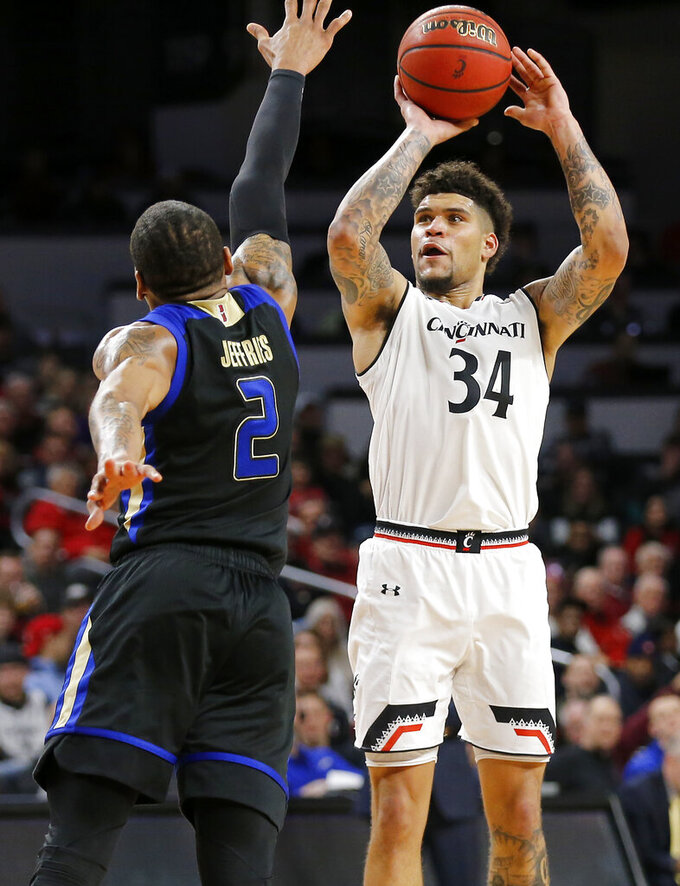 Cincinnati guard Jarron Cumberland (34) shoots over Tulsa guard DaQuan Jeffries (2) during the second half of an NCAA college basketball game Thursday, Jan. 24, 2019, in Cincinnati. Cincinnati won 88-64. (Sam Greene/The Cincinnati Enquirer via AP)