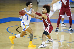 Washington State guard Isaac Bonton, right, defends against UCLA guard Jules Bernard (1) during the first half of an NCAA college basketball game Thursday, Jan. 14, 2021, in Los Angeles. (AP Photo/Ashley Landis)