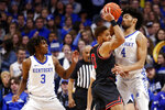 Georgia's Donnell Gresham Jr., middle, and Kentucky's Nick Richards (4) collide as Tyrese Maxey (3) looks on during an NCAA college basketball game in Lexington, Ky., Tuesday, Jan 21, 2020. (AP Photo/James Crisp)