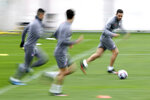 Atletico Madrid's Koke Resurreccion, right, takes part in a training session in Majadahonda, outskirts of Madrid, Spain, Monday, Feb. 17, 2020. Atletico Madrid will play its Champions League soccer match against Liverpool next Tuesday. (AP Photo/Manu Fernandez)