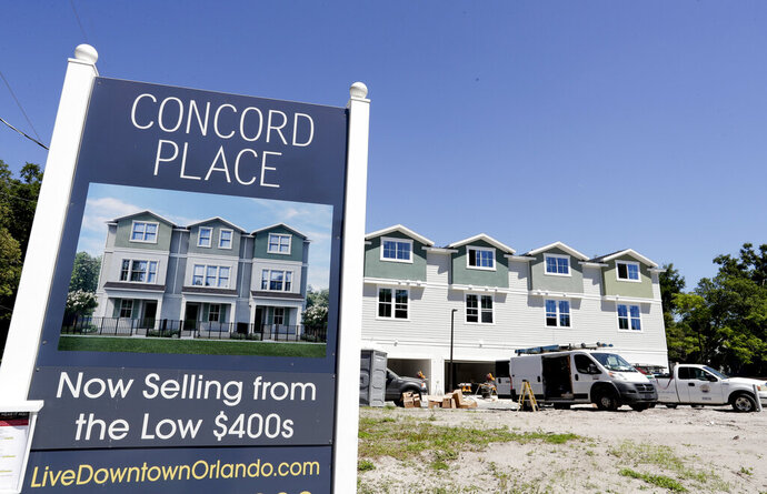 FILE - In this April 16, 2019, file photo, new condos under construction are being built in vacant lots in a neighborhood near downtown Orlando, Fla. The Federal Housing Administration is changing regulations to make it easier for more first-time condo buyers to receive mortgages. The federal agency released new guidelines Wednesday for the types of mortgages it will insure at condominiums. (AP Photo/John Raoux, File)