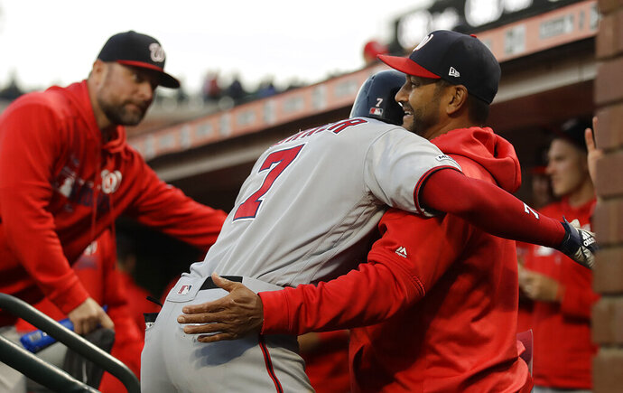 Washington Nationals' Trea Turner (7) is congratulated after hitting a home run against the San Francisco Giants during the fifth inning of a baseball game Tuesday, Aug. 6, 2019, in San Francisco. (AP Photo/Ben Margot)