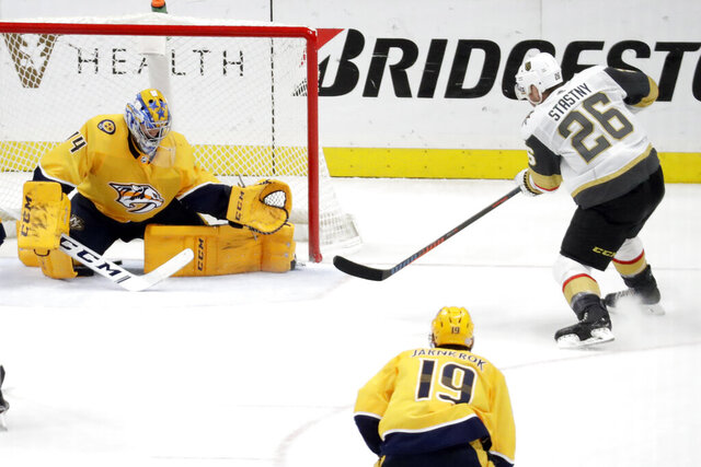 Vegas Golden Knights center Paul Stastny (26) scores the winning goal against Nashville Predators goaltender Juuse Saros (74), of Finland, in overtime of an NHL hockey game Wednesday, Nov. 27, 2019, in Nashville, Tenn. The Golden Knights won 4-3. (AP Photo/Mark Humphrey)