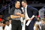 Cincinnati coach John Brannen argues with an official during the first half of the team's NCAA college basketball game against Tulsa on Wednesday, Jan. 8, 2020, in Cincinnati. (Kareem Elagazzar/The Cincinnati Enquirer via AP)
