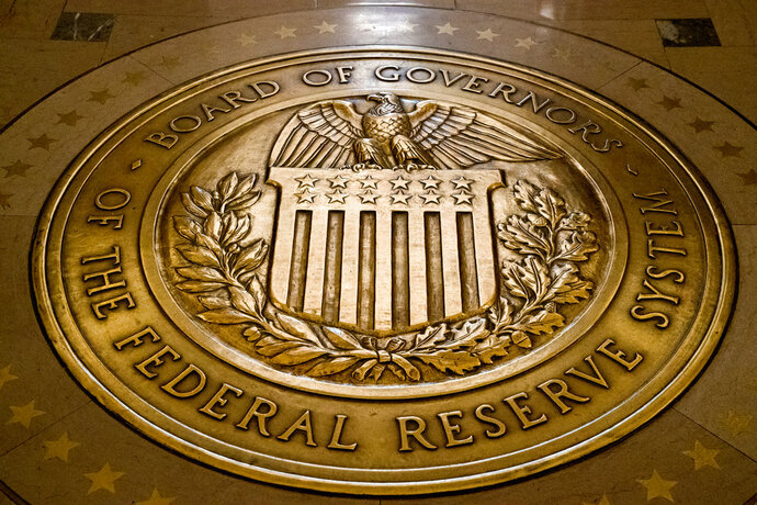 FILE- In this Feb. 5, 2018, file photo, the seal of the Board of Governors of the United States Federal Reserve System is displayed in the ground at the Marriner S. Eccles Federal Reserve Board Building in Washington. President Donald Trump has selected Columbia University professor Richard Clarida to be vice chairman of the Federal Reserve and Kansas bank commissioner Michelle Bowman to fill another vacancy on the Fed's seven-member board. (AP Photo/Andrew Harnik, File)