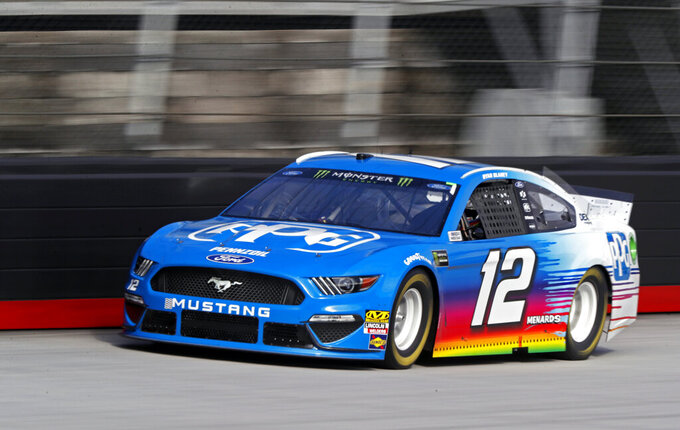 Driver Ryan Blaney (12) makes his way down the back stretch during practice for a NASCAR Cup Series auto race, Saturday, April 6, 2019, in Bristol, Tenn. (AP Photo/Wade Payne)