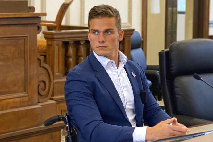 In this undated photo made available by Stephen Smith, GOP primary candidate Madison Cawthorn participates in a debate at the Haywood County Courthouse in Waynesville, N.C. Cawthorn, 24, soundly defeated the preferred candidate of President Donald Trump. He defeated Lynda Bennett by a 2-1 margin. (Stephen Smith via AP)