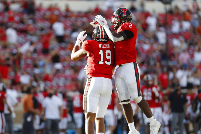 Texas Tech defensive lineman Tyree Wilson celebrates his sack with linebacker Brandon Bouyer-Randle during the second half of an NCAA college football game against Texas Tech, Saturday Sept. 26, 2020, in Lubbock, Texas. (AP Photo/Mark Rogers)