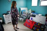 Lori Alhadeff, mother of 14-year-old Alyssa Alhadeff who was one of 17 people killed at Marjory Stoneman Douglas High School, stands in her daughter's bedroom on Wednesday, Jan. 30, 2019, in Parkland, Fla. Much of the teenager's turquoise-colored bedroom remains untouched. Her retainer is still there, as are mementos of teammates and friends. And her dirty clothes are still in the hamper by the bed.