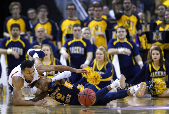 Belmont's Michael Benkert (24) and Murray State's Ja Morant (12) fight for a loose ball during the second half of an NCAA college basketball game for the Ohio Valley Conference men's tournament championship in Evansville, Ind., Saturday, March 9, 2019. (Sam Owens/Evansville Courier & Press via AP)