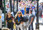 United States women's soccer team members Allie Long, center, and Alex Morgan walk to a hotel Monday, July 8, 2019, in New York. The city will honor the team with a parade Wednesday for their fourth Women's World Cup victory. (AP Photo/Corey Sipkin)
