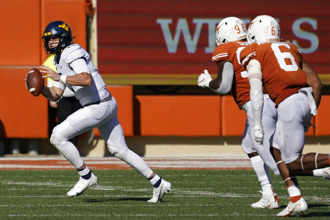West Virginia quarterback Jarret Doege (2) scramble against Texas during the second half of an NCAA college football game in Austin, Texas, Saturday, Nov. 7, 2020. (AP Photo/Chuck Burton)
